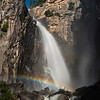 "Last year Willie, Will, and I got our first great moonbow photo while on top of the Upper Yosemite Falls trail. Thanks to some professors in Texas just about anyone can find out when the moon bows in Yosemite will occur. Trying to avoid the hoards of crowds at the Sentinal Bridge parking lot we decided to try to find a more unique moonbow and something different from last year. Willie and I had seen a number of timescape videos, most notably Steve Bumgardner's official video for the Yosemite Conservancy, in which moonbows were photographed at Cascade Falls. We knew we had to try this!   <br /> <br /> I spent a lot of time trying to figure out how to get to the proper location to shoot a moonbow at Cascade Falls. You need to get high enough and east enough to get around a jut in the rocks (you can see it here, where the water flows over, blocking the top of the falls) to get the proper angle to see the top of the falls, which has a really nice ""S"" curve to it. I used Google Earth and a number of other peoples images to get a vague idea of what we had to do. We found out that Steve traveled up from the bottom (along highway CA-140) but I thought you might be able to drop in from the top. When I arrived at Yosemite on Saturday I quickly ruled out the top-down approach. I hopped in the car, drove down to the bottom, and started on up. After an hour of completely sweating, super steep climbing, and searching high and low, I gave up on finding ""the perfect spot"". It was just too dangerous and without proper climbing gear I couldn't see any way to get to the spot that Steve took his photo.<br /> <br /> Dropping down a bit we found a nice area that gave a beautiful view of the main falls. In the afternoon weather the area was dry and pretty easy to get to. When Willie, Will, and I returned at night we were in for a shock -- the winds had picked up and were spraying mist all over the spot! Not wanting to be drenched for 2 hours we moved back to a safe distance where we go stay both dry and warm. There was a super moon this evening (the largest moon of the year) and we had hoped that its brightness would put on a great moonbow show, but we didn't know when exactly it would start. Every so often I would head back out to the falls to double check on the moonbow. Finally around 9:10pm we saw a faint bow and raced back to get our gear. It was super slippery on the rocks to our spots and we took extra caution not to slip and die. By now it felt like it was raining and we knew we had to be quick to get our shots.<br /> <br /> Proper planning was key to this. I brought along a rain-shield for my camera to keep my camera dry and attached the hood to the lens helped reduce a small amount of water hitting the lens. I also brought along 5 micro-fiber cloths because I knew I'd be wiping the lens dry quite often and they would get wet fast. I had just enough time to wipe the lens clean and then take a shot before the lens was completely covered. I went through 3 micro-fiber cloths in the 35 minutes that we were out there. Once we finally returned to dry land we realized how *completely* soaked we all were. It wasn't until the sun came up the next day that I was able to fully dry all my equipment! <br /> <br /> This years moon bows were much more faint than last years. We could just make out a silvery bow with our eyes, compared to last years full blast of color. Additionally, it wasn't until I looked at the LCD later that I realized we caught a small hint of a DOUBLE MOONBOW! <br /> <br /> Nikon D700 w/Nikkor 24-70mm f/2.8G ED AF-S:<br /> 42mm, f/4, 30 sec, ISO 640"