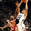 CUVSWASHSTATE24.JPG University of Colorado's #23 Sabatino Chen pulls down a rebound over Washington State's #34 Dexter Kernich-Drew and #0 Marcus Capers during their game at the Coors Events Center on the University of Colorado Boulder, Colo. Campus on Saturday January 7, 2012<br /> Photo by Paul Aiken  Jan 7, 2012