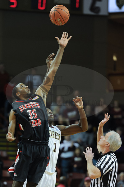 Gardner Webb Runnin Bulldogs forward Jerome Hill (35) wins the opening tip in the first half of an NCAA basketball game between Gardner-Webb Runnin' Bulldogs and the College of Charleston Cougars at TD Arena. Gardner-Webb defeats College of Charleston 55-52.