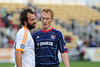 Chicago Fire midfielder Jeff Larentowicz (20) and Houston Dynamo midfielder Adam Moffat (16) have words after and injury to a Fire player during an MLS exhibition between the Chicago Fire and the Houston Dynamo during opening night of the Carolina Challenge Cup at Blackbaud Stadium.