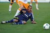 Chicago Fire forward Sherjill MacDonald (7) is stepped on by a Houston Dynamo player during an MLS exhibition between the Chicago Fire and the Houston Dynamo during opening night of the Carolina Challenge Cup at Blackbaud Stadium.