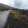 The lava field. In the right you can see the old road that got covered up. They made a new one … for now.