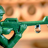 Close up toy soldier with tank reflection in drops