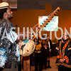 "The ""Kora"" instrument is played while Smithsonian director Johnnetta Cole and the audience listens"