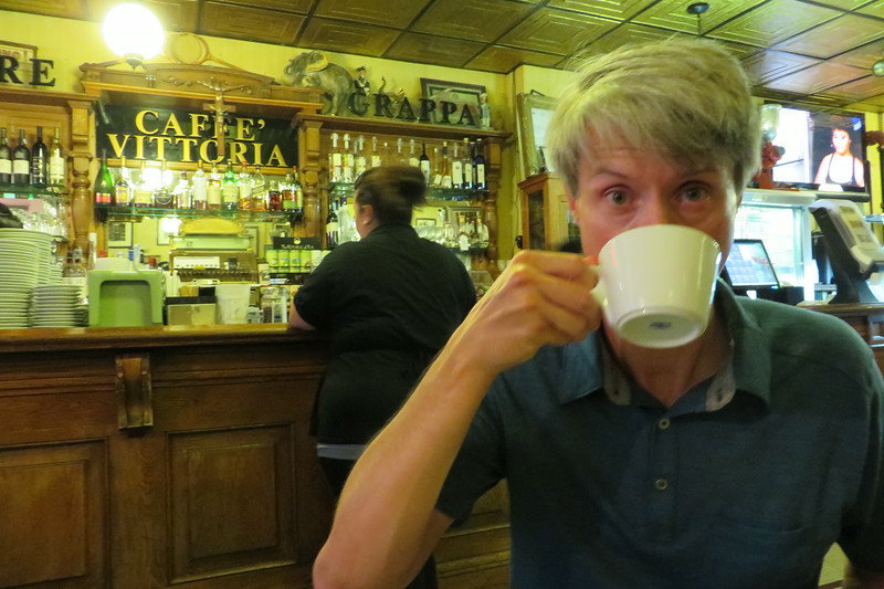 Brandon enjoying an espresso at Caffe Vittoria