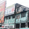 Decades old buildings covered with huge modern signage, near Quiapo