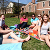 A group of Gardner-Webb University students take advantage of the warm spring day on the quad.