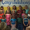 Wyatt singing with his classmates at kindergarten Graduation.