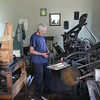 man working on printing press