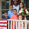 The Spearman family poses for a picture on the front porch of their new home following Habitat for Humanity of Greater Newburgh's dedication on East Parmenter St. in the City of Newburgh on Saturday, June 14, 2014 to complete the week long Builders Blitz. Hudson Valley Press/CHUCK STEWART, JR.