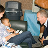"US Rep Sean Patrick Maloney speaks with Selina Ronero and her seven-month old baby Noah after he hosted ""When Women Succeed, America Succeeds"" Forum and Resource Fair Saturday, July 26 at the Orange County Emergency Services Center in Goshen, NY. Hudson Valley Press/CHUCK STEWART, JR."