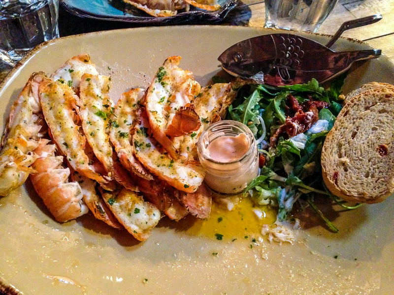 """That night we had a delicious meal in the town of Höfn (pronounced """"Hop-in""""). Here I had an amazing platter of Langostine tails ... it translates to lobster but it's more like the taste and texture of shrimp! So delicious, especially that cranberry bread!"""
