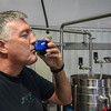 Scott Willoughby tastes the first sample of olive oil.  (Nathan DeHart-Ukiah Daily Journal)