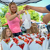 Rebecca Landers, 3, is with her mother buying strawberries from El Perdenal at the Farmer's Market. (Nathan DeHart-Ukiah Daily Journal)