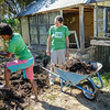 Joanne Felix, left, and Angela Powell are moving compost. (Nathan DeHart-Ukiah Daily Journal)