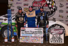 Jackie Boggs with Steve Francis and Jared Landers in Victory Lane