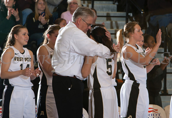 Army head coah Dave Magarity hugs Kelsey Minato (5) in the final moments of their Patriot League Tournament Semifinal game against American at the United States Military Academy's Christl Arena in West Point, NY on Monday, March 10, 2014. Army defeated American, 68-55, to advance to the finals. Hudson Valley Press/CHUCK STEWART, JR.
