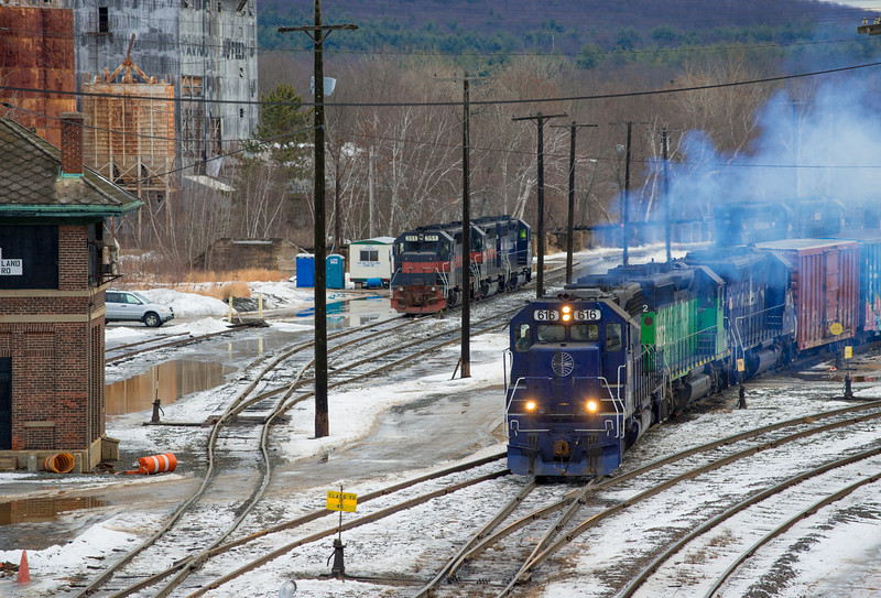 Pan Am's EDMO (East Deerfield to Mohawk Yard) departs East Deerfield with two blues and a green SD40-2s on January 12, 2014.