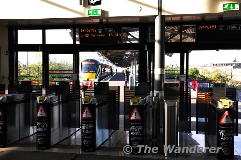 Docklands Station Ticket Barriers. 22041 waits to depart for M3 Parkway. Tues 15.04.14