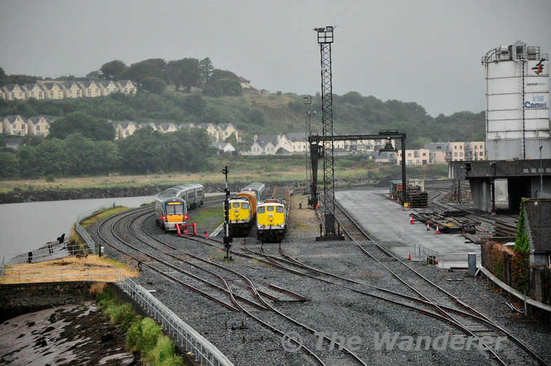 Waterford Sally Park Yard early on Friday 18th July 2014. To the left is 22046 + 22049 which will form the 0710 Waterford - Heuston, then 079 with the 0700 Weedspray Train to Rosslare Strand, behind that is 22048 which will be the 0720 Waterford - Limerick Jct. Finally, 083 is stabled with the Pocket Wagons bound for Belview Port. Fri 18.07.14