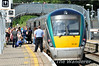 Under the watchful eye of the Train Host, passengers board 22021 at Thurles. 1420 Cork - Heuston. Sun 27.07.14