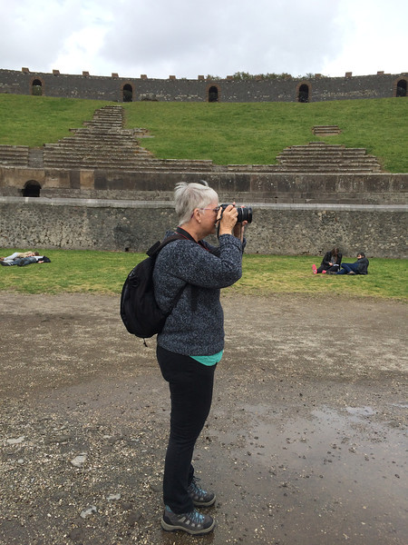Perfect capture of how I usually look, with a camera plastered to my face, backpack, and hiking boots, inside the Amphitheater in the ruins of Pompeii, Italy