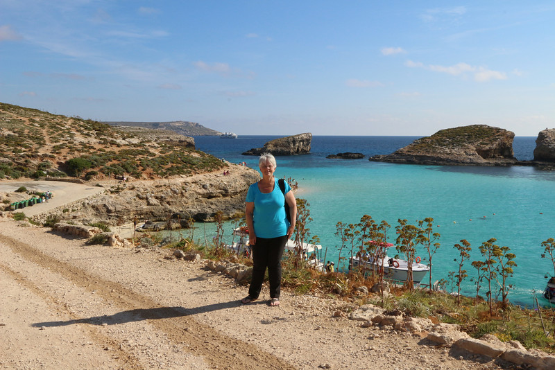 Hiking the cliff paths overlooking the Blue Hole on the island of Camino, in the Maltese Islands