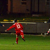 St. Helens Town's Colin Quirk and AFC Liverpool's Nevil Picton chase the ball.