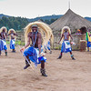Native Villagers in costume for tourists in Rwanda village.
