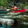 Pin ball spring open canoeing in boulder strewn Twenty Day Rapids on the Wolf River (USA WI White Lake)
