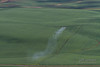 Crop Dusting - An aerial applicator spraying a field using a Thrush airplane!