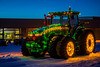 A John Deere tractor farm implement illuminated at night near Carmen, Manitoba, Canada.