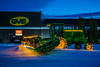 John Deere grain swather illuminated for Christmas near Winkler, Manitoba, Canada.