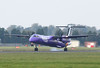 "Circuit training this afternoon was Flybe's DHC-8-400, G-JECE, it is the first ""Purpleised"" example to visit DSA.<br /> By Clive Featherstone."