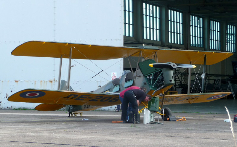 A pleasant surprise outside No3 hangar was the sight of this 1941 built DH82A Tiger Moth, DE208 (G-AGYU), back in one piece after being damaged in a landing accident in July 2012.<br /> By Jim Calow.