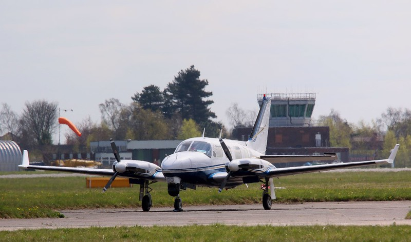 2 Excel Aviation, PA-31 Navajo, G-BEZL parked in the sunshine<br /> By Correne Calow.