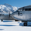 A pair of C-119's in winter slumber awaiting the thaw when their engines will roar again in Palmer, Alaska.