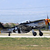 """the P-51D """"Lady Alice"""" rolls out after landing at the 2014 Planes of Fame airshow in Chino, CA."""