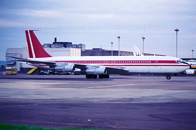 EL-AJT. Boeing 707-344B. Omega Air. Glasgow. 1980`s.  Negative scan.