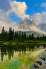 Mount Kidd reflects on a Beaver Pond as clouds swirl above, in Canada's Kananaskis Country Provincial Park. Captured with a Canon 5D III and 17-40/4.0L in manual mode at ISO100, f/11, and 1/30th of a second (In Camera HDR). The camera was mounted on a Gitzo 3541 XLS with an Arca-Swiss Z1sp a Singh-Ray LB Polarizer and 2-stop soft Singh-Ray Graduated Neutral Density Filter was used, as was an intervalometer remote was used.