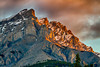 The rising sun illuminating Cascade Mountain in Banff National Park, Alberta, Canada.