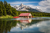 Reflections of the Boat House at Maligne Lake, Jasper National Park, Alberta, Canada.