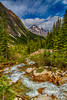 A glacier stream and Pyramid Mountain in Jasper National Park, Alberta, Canada.
