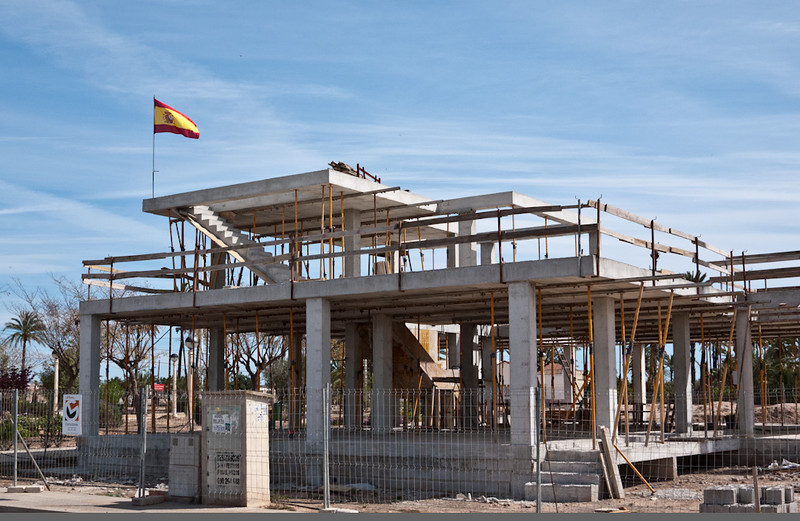 7 April 2013: an apparently abandoned construction project with the flag flying proudly above it--an illustration of Spain's economic situation right now.