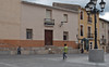 23 February 2013: small-town life in Spain. Two boys play on the square in front of the church, Aigües.