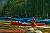 Early spring open canoeing of ice and snow guarded Boy Scout Rapids on the Wolf River (USA WI White Lake)