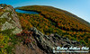 Blue skies and blazing autumn hardwoods and granite escarpments surround Lake of the Clouds Scenic Area within Porcupine Mountains Wilderness State Park (USA MI Ontonagon)