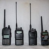 My HT collection.  From left to right, Yaesu FT-270, Yaesu FT-60, Wouxun KG-UVA1 (Part 90) and Baofeng UV-5rE (also Part 90.)