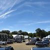 a view of only some of the back parking lot and stabling tents