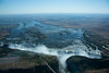 VICTORIA FALLS    Aerial view.   The Zambezi River flows for hundreds of miles in a broad gentle stream then plunges into a huge fissure.